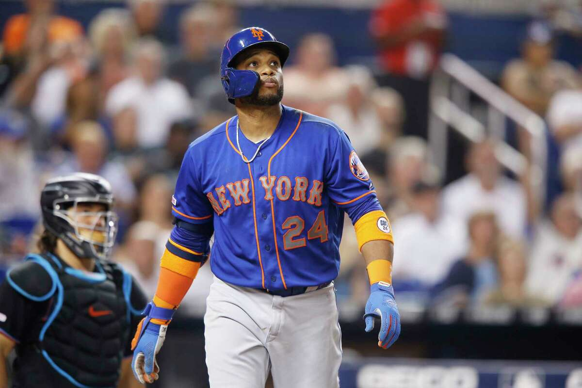 MIAMI, FLORIDA - JULY 13: Robinson Cano #24 of the New York Mets watches his two-run home run leave the field in the eighth inning against the Miami Marlins at Marlins Park on July 13, 2019 in Miami, Florida. (Photo by Michael Reaves/Getty Images)
