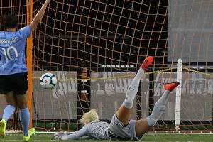 Houston Dash goalkeeper Jane Campbell (1) misses a shot by Chicago Red Stars forward Katie Johnson (33) during the first half of a NWSL game at BBVA Stadium on Saturday, July 13, 2019, in Houston.