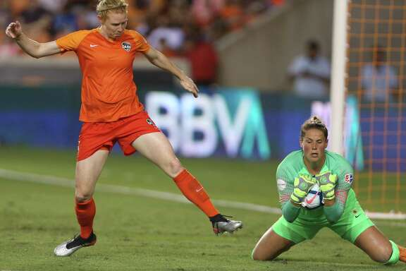 Chicago goalkeeper Emily Boyd, right, wraps up the ball before Dash defender Clare Polkinghorne can get to it in the box during the second half of Saturday night's game at BBVA Stadium. The Red Stars won 1-0.