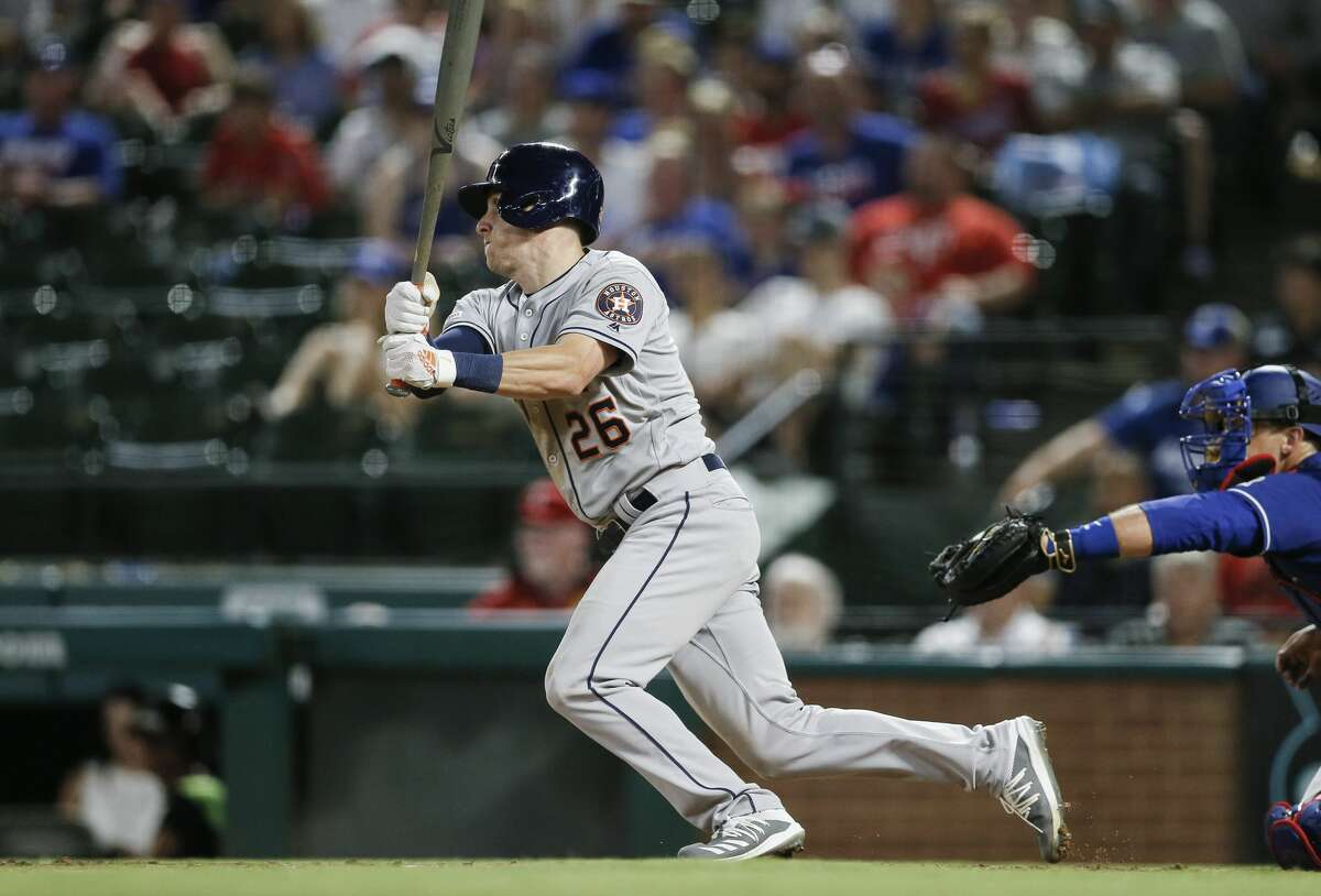 Houston Astros' Myles Straw watches his RBI single during the 11th inning of the team's baseball game against the Texas Rangers, Saturday, July 13, 2019, in Arlington, Texas. Houston won 7-6 in 11 innings. (AP Photo/Brandon Wade)