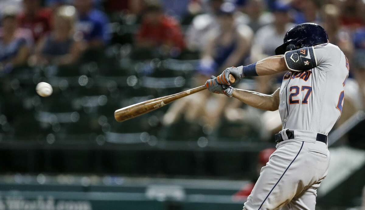Houston Astros' Jose Altuve hits an RBI double during the 11th inning of the team's baseball game against the Texas Rangers on Saturday, July 13, 2019, in Arlington, Texas. Houston won 7-6 in 11 innings. (AP Photo/Brandon Wade)