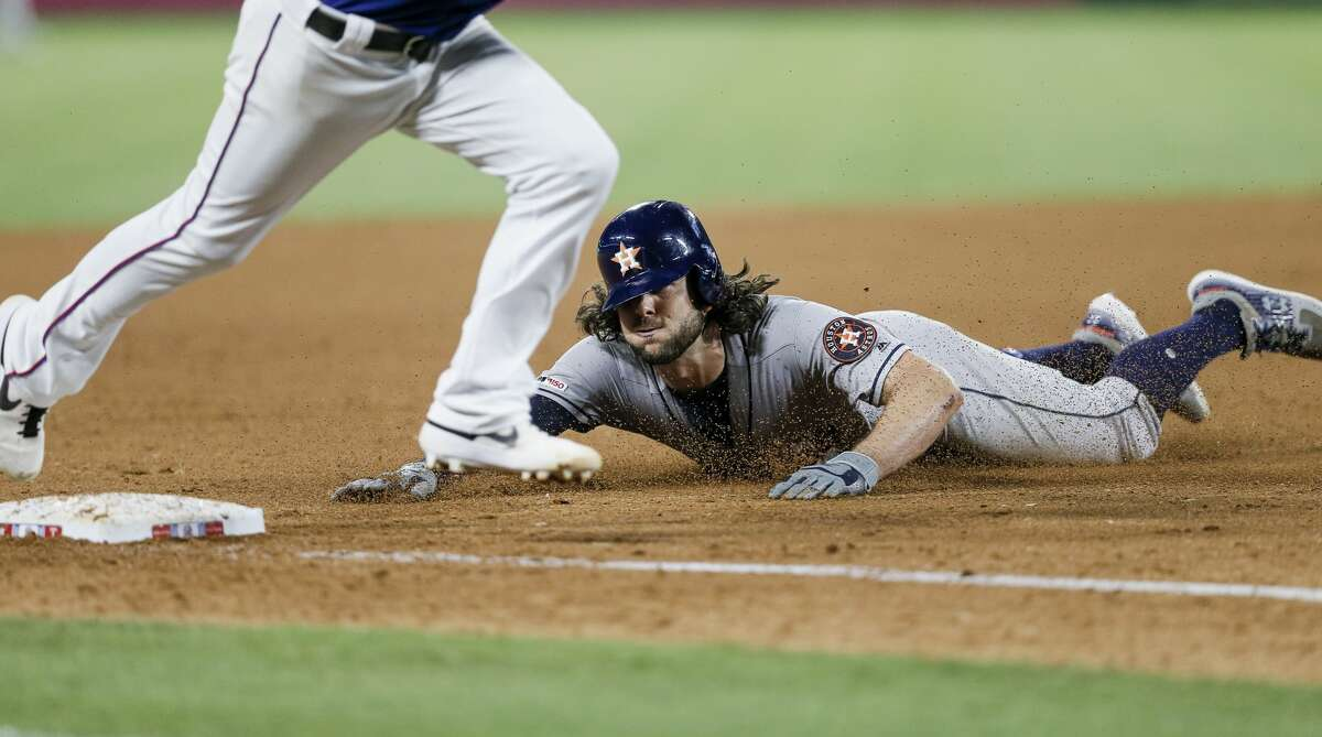 Houston Astros' Jake Marisnick (6) slides into third on a triple during the eighth inning of the team's baseball game against the Texas Rangers, Saturday, July 13, 2019, in Arlington, Texas. Houston won 7-6 in 11 innings. (AP Photo/Brandon Wade)