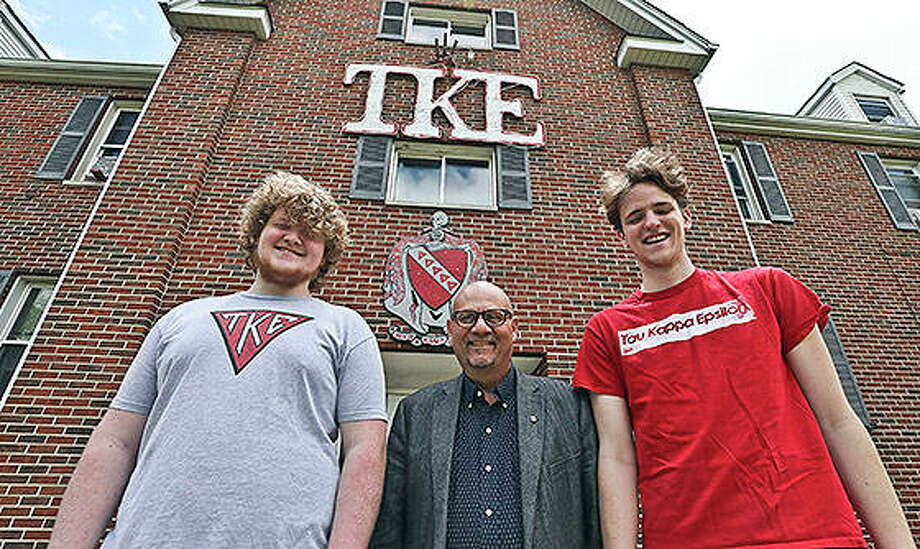 Tony Caccomo (center) talks with TKE members Greg Marshall (left) and Niall Sullivan at the TKE fraternity house on the campus of Millikin University. One of the largest fraternities in the country can trace its roots to the campus of Millikin University. Tau Kappa Epsilon — or TKE — was formed in 1899 at Illinois Wesleyan in Bloomington. Ten years later, the second chapter was created at Millikin. Photo: Jim Bowling | Herald & Review (AP)