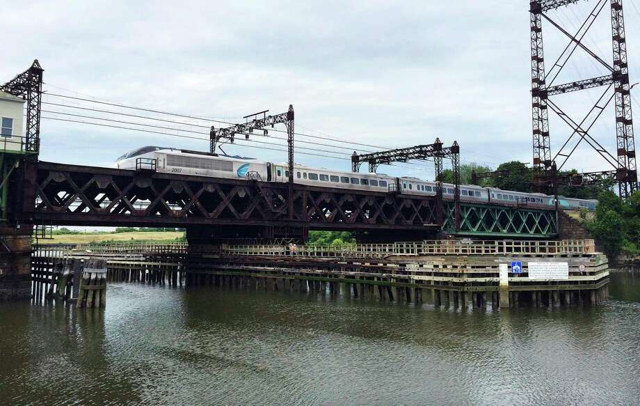 FILE - In this June 20, 2018 file photo, Amtrak's Acela Express crosses the Norwalk River Railroad Bridge, also known as the Walk Bridge, in Norwalk, Conn. Photo: Susan Haigh / Associated Press / Copyright 2019 The Associated Press. All rights reserved.