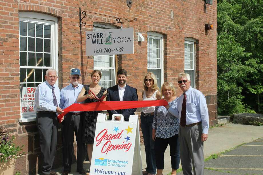 Starr Mill Yoga, 91 Beverly Heights, Middletown, held a ribbon cutting June 6. From left are owner Sybil Merriman, her family, Mayor Dan Drew, Middlesex County Chamber of Commerce ambassador Sue Anne Podaski, Small Business Development Counselor Steve Ciskowski and President Larry McHugh. Photo: Contributed Photo
