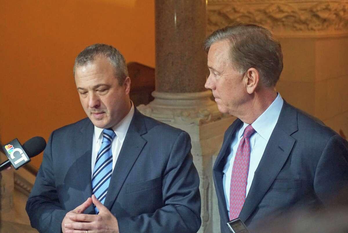 Jonathan Harris, left, will soon take over as Connecticut Gov. Ned Lamont's senior adviser.