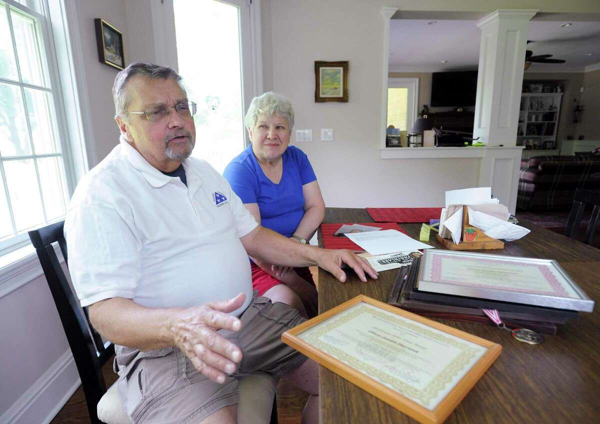 With his wife Barbara at his side, Joseph Havranek talks about some of his fondest memories and experiences he has had during an interview at his home in Greenwich, Conn. on July 12, 2019. Havranek has been a volunteer for 40 years, and recently stepped down as an auxiliary police officer with the Greenwich Police Department.