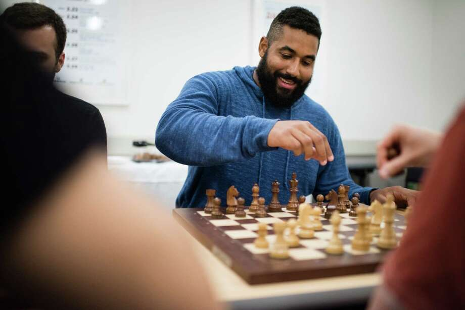 Research suggests that making five lifestyle adjustments - including playing mentally stimulating games like chess - will decrease your chance of Alzheimer's by 60 percent. Photo: Washington Post Photo By Sarah L. Voisin / The Washington Post