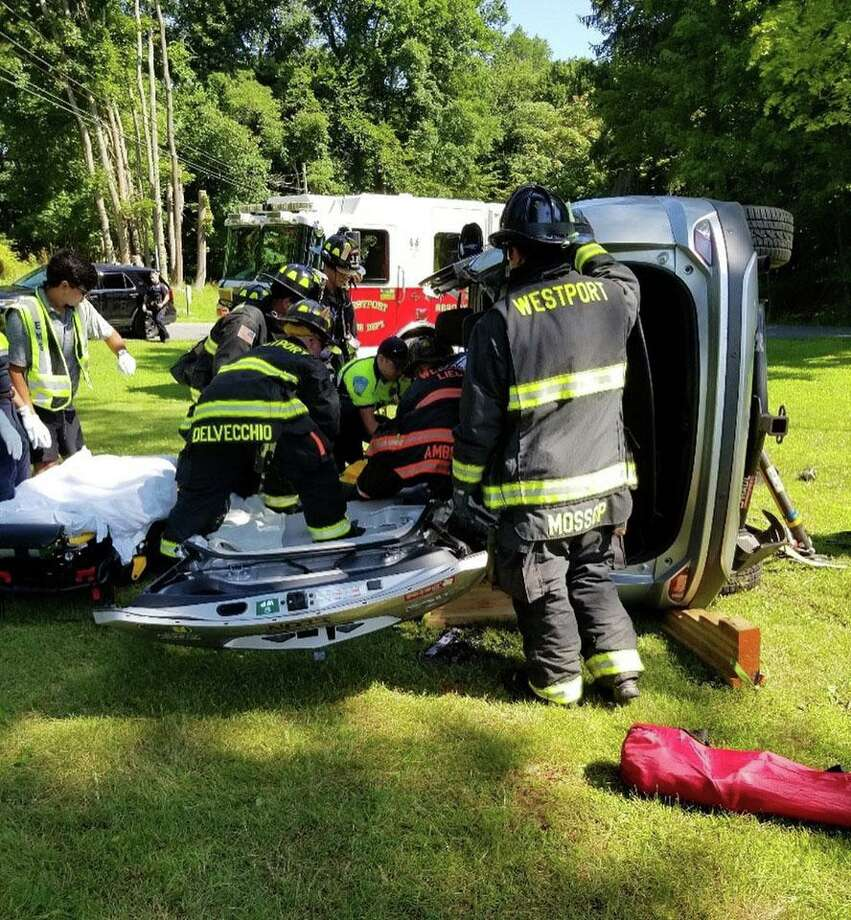 A driver was sent the hospital on Sunday, July 14, 2019 after a rollover crash in Westport. Photo: Contributed Photo/Wesport Fire Department Facebook / Contributed / The News-Times Contributed