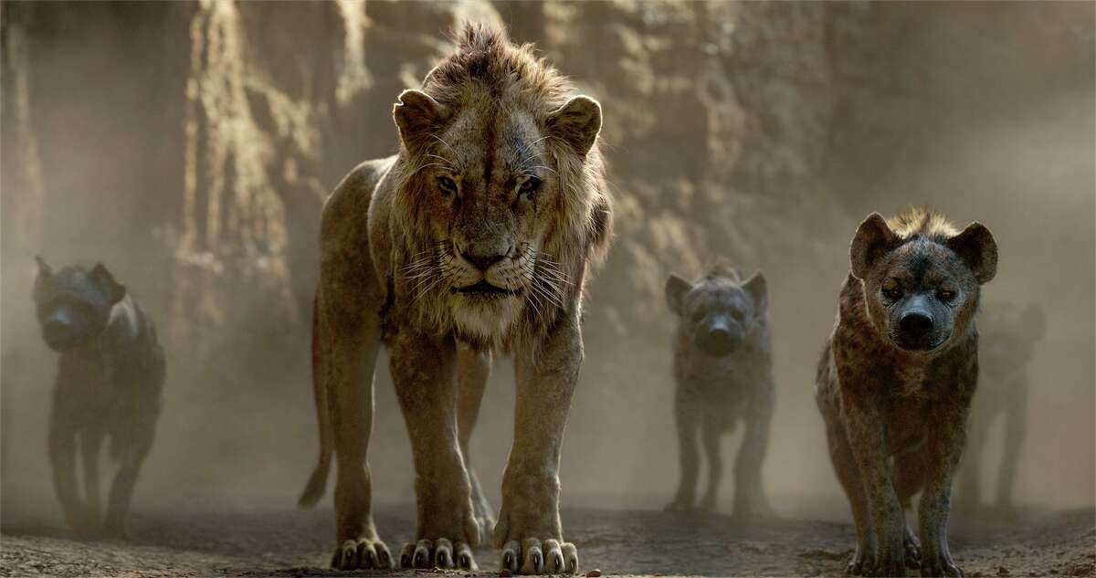 Three hyenas (voiced, from left, by Florence Kasumba, Eric André and Keegan-Michael Key) flank the villainous Scar (Chiwetel Ejiofor) in Disney's