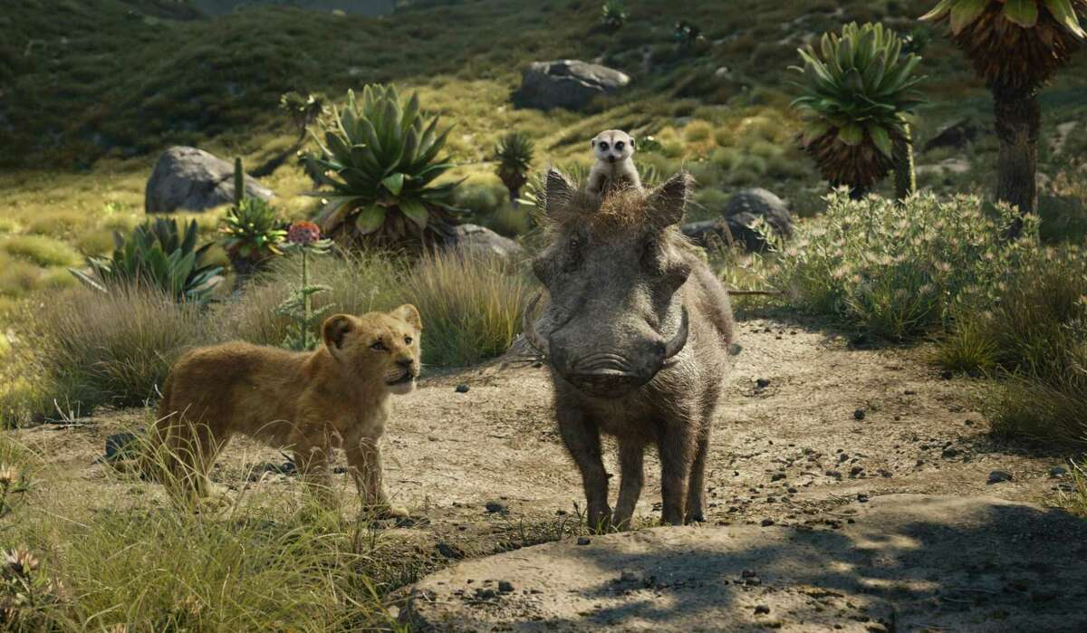 Young Simba the lion cub (voiced by JD McCrary, left) meets Pumbaa the friendly warthog (Seth Rogen) and his sidekick, Timon the meerkat, in