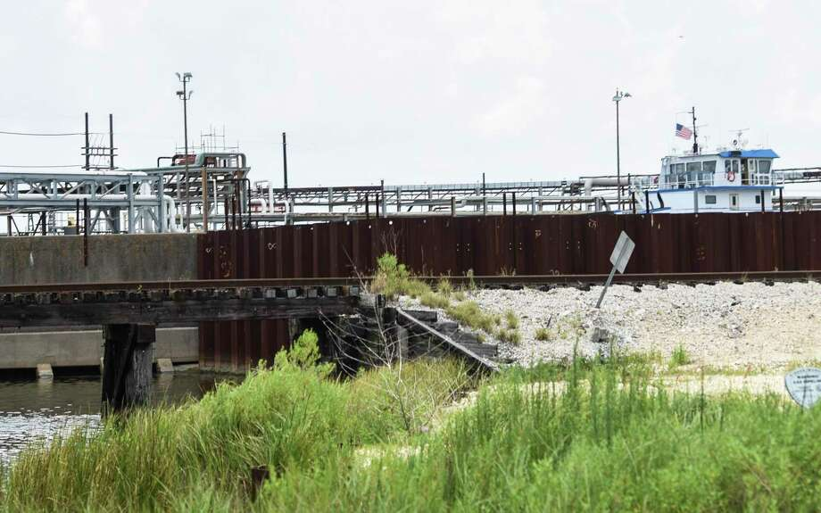 A metal wall surrounds part of a levee near Port Arthur's Valero refinery off of Texas State Highway 87 Thursday afternoon. Photo taken on Thursday, 07/11/19. Ryan Welch/The Enterprise Photo: Ryan Welch, Beuamont Enterprise / The Enterprise / © 2019 Beaumont Enterprise