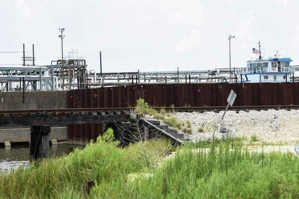 A metal wall surrounds part of a levee near Port Arthur's Valero refinery off of Texas State Highway 87 Thursday afternoon. Photo taken on Thursday, 07/11/19. Ryan Welch/The Enterprise