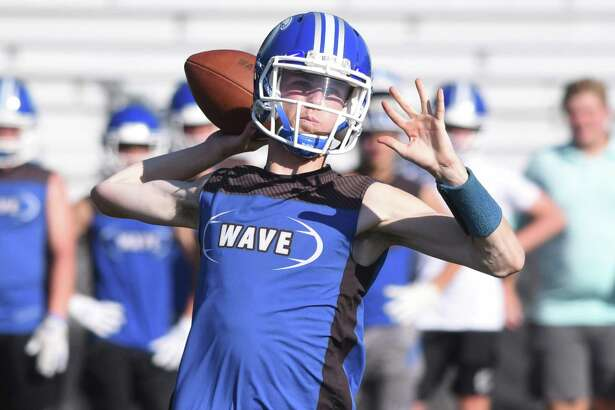 Darien's Peter Graham throws a pass during the annual Grip It and Rip It football tournament in New Canaan on Friday, July 12, 2019.