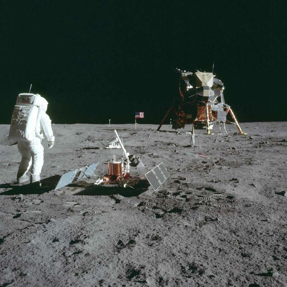 In this July 20, 1969 photo made available by NASA, astronaut Buzz Aldrin Jr. stands next to the Passive Seismic Experiment device on the surface of the the moon during the Apollo 11 mission. Photo: Neil Armstrong /Associated Press / NASA