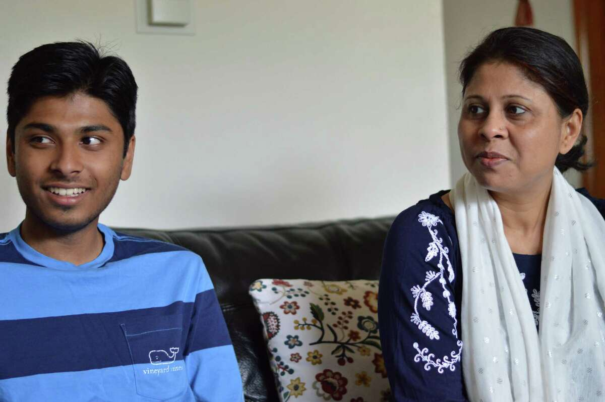 Anwar Mahmud, Samir Mahmud and Salma Sikandar sit in their living room in New Haven July 11, 2019 days before they have to appear in immigration court to hear a judges decision on the parents' deportation case.