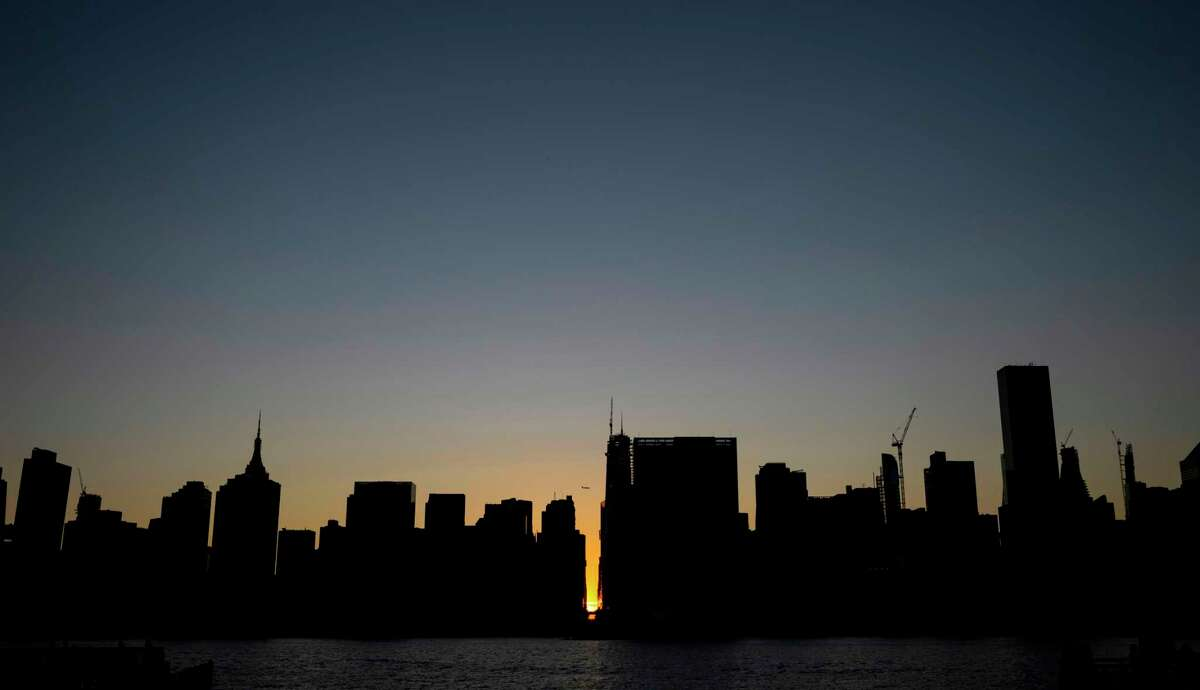 The sun sets behind 42nd Street in Manhattan during a power outage in New York City on July 13, 2019. - Subway stations plunged into darkness and the billboards of Times Square suddenly flicked off as New York's Manhattan was hit by a power outage on Saturday. About 42,000 customers lost electricity in the early evening, according to the Con Edison utility, which did not give a reason for the cut. (Photo by Johannes EISELE / AFP)JOHANNES EISELE/AFP/Getty Images