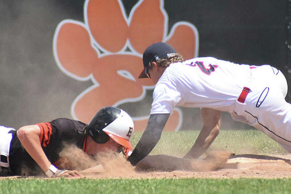 Edwardsville's Gavin Huebner slides safely back into second base during Sunday's game at Tom Pile Field.