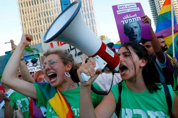 Members of the LGBT community rally against Israel's Education Minister Rafi Peretz following his remarks on gay conversion therapy, in the Israeli coastal city of Tel Aviv on July 14, 2019. - Peretz has spoken in a television interview of his belief in therapy to convert gays to heterosexuality and claimed he has engaged in the practice, leading to calls for him to be sacked. (Photo by JACK GUEZ / AFP)JACK GUEZ/AFP/Getty Images