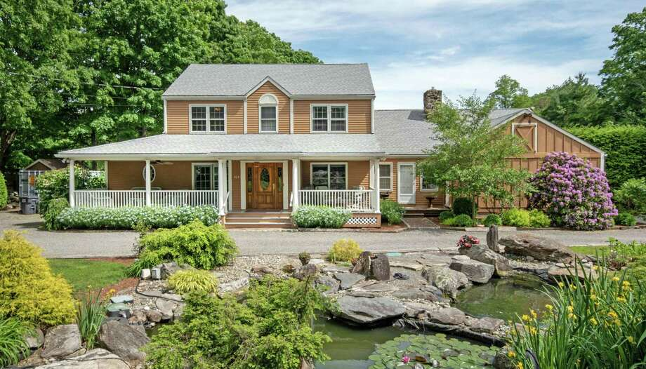 Maple Meadow Farm, at 109 Maple Road, features a 3,340-square-foot colonial house, a barn, paddock, stable, and koi pond.