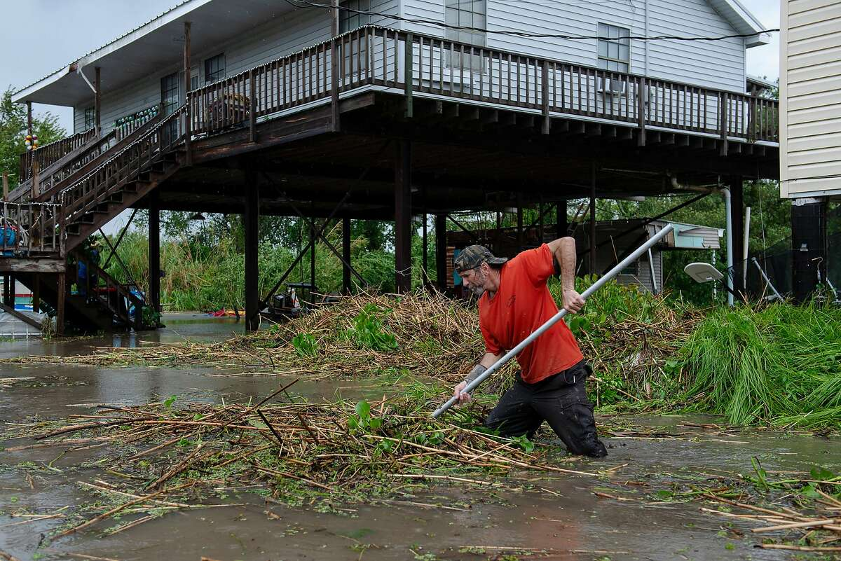 Rowdy Schouest clears debris following Tropical Storm Barry, in Franklin, La., on July 14, 2019. After a brief life as a Category 1 hurricane, Barry was downgraded to a tropical storm as it made landfall and continued to weaken, moving slowly north over the state as life-threatening flooding rains remained the primary threat. (Bryan Thomas/The New York Times)
