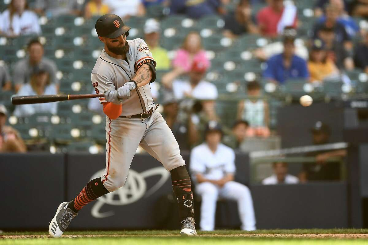 Kevin Pillar #1 of the San Francisco Giants swings at a pitch during the ninth inning against the Milwaukee Brewers at Miller Park on July 14, 2019 in Milwaukee, Wisconsin.