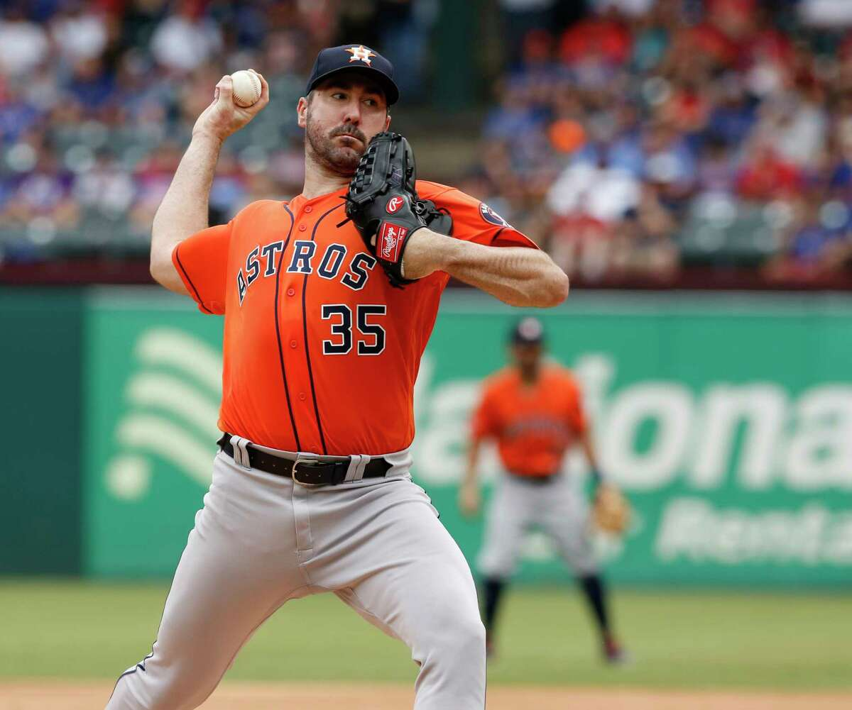 Houston Astros starting pitcher Justin Verlander throws against the Texas Rangers in the first inning of a baseball game against the Texas Rangers, Sunday, July 14, 2019, in Arlington, Texas. (AP Photo/David Kent)