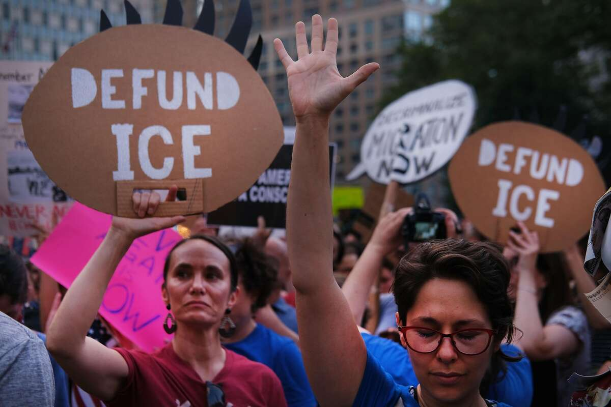 """NEW YORK, NY - JULY 12: Hundreds of people gather in lower Manhattan for a """"Lights for Liberty"""" protest against migrant detention camps and the impending raids by Immigration and Customs Enforcement (ICE) this coming weekend in various cities on July 12, 2019 in New York City. Fear is increasing in many immigrant neighborhoods as ICE is scheduled to begin rounding up illegal immigrants in cities across the nation starting on Sunday. (Photo by Spencer Platt/Getty Images)"""