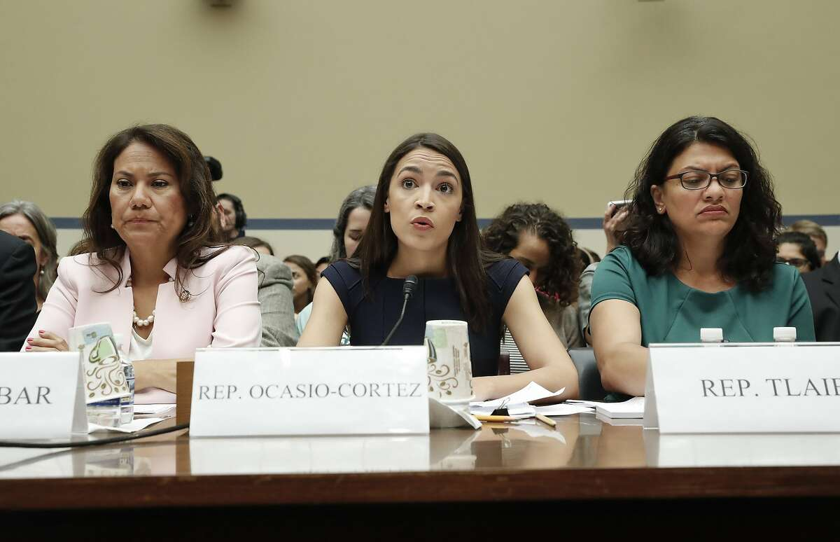 Rep. Alexandria Ocasio-Cortez, D-NY., center, seated with Rep. Veronica Escobar, D-Texas, left, and Rep. Rashida Tlaib, D-Mich., right, testifies before the House Oversight Committee hearing on family separation and detention centers, Friday, July 12, 2019 on Capitol Hill in Washington. (AP Photo/Pablo Martinez Monsivais)
