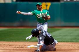 OAKLAND, CA - JULY 14:  Marcus Semien #10 of the Oakland Athletics completes a double play over Yoan Moncada #10 of the Chicago White Sox during the third inning at the RingCentral Coliseum on July 14, 2019 in Oakland, California. (Photo by Jason O. Watson/Getty Images)