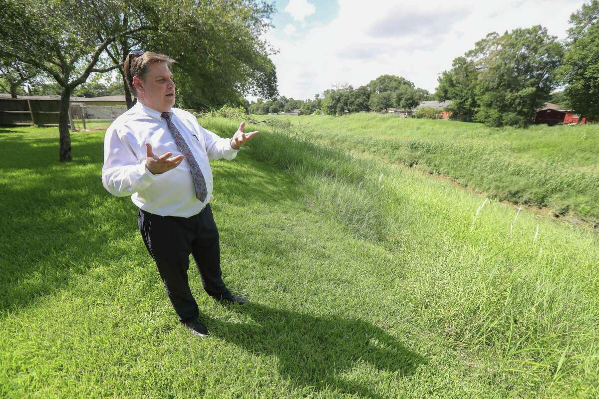 Bob McGrew talks about the proposed change to mercury testing of Berry Bayou that runs through the back of his property Tuesday, July 9, 2019, in Houston.