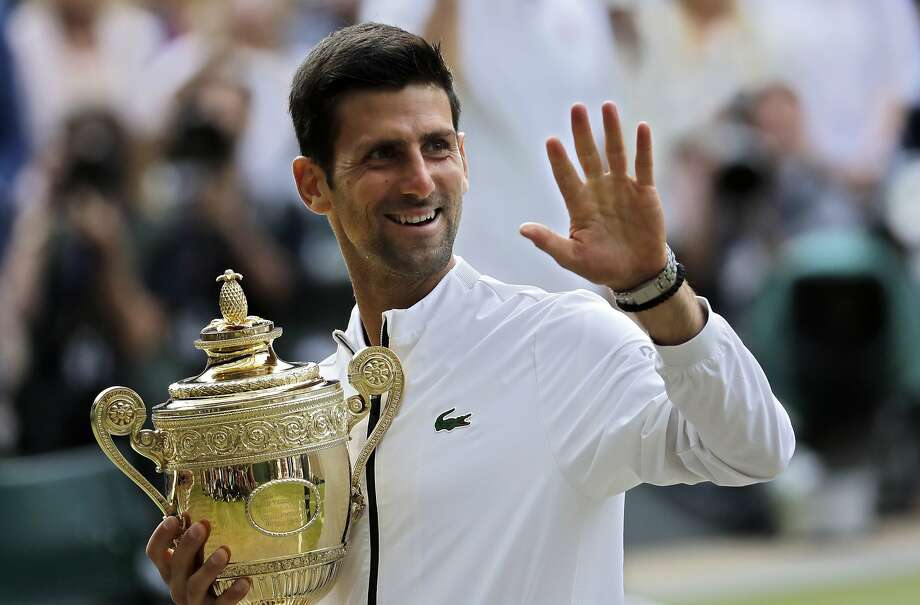 Serbia's Novak Djokovic holds his trophy after defeating Switzerland's Roger Federer in the men's singles final match of the Wimbledon Tennis Championships in London, Sunday, July 14, 2019. (AP Photo/Ben Curtis) Photo: Ben Curtis / Associated Press