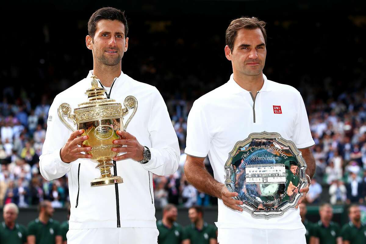 LONDON, ENGLAND - JULY 14: Novak Djokovic of Serbia and Roger Federer of Switzerland pose for a photo with their trophies after the Men's Singles final during Day thirteen of The Championships - Wimbledon 2019 at All England Lawn Tennis and Croquet Club on July 14, 2019 in London, England. (Photo by Clive Brunskill/Getty Images)