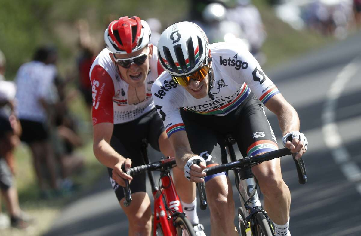 South Africa's Daryl Impey, right, and Belgium's Tiesj Benoot ride during the ninth stage of the Tour de France cycling race over 170.5 kilometers (105.94 miles) with start in Saint Etienne and finish in Brioude, France, Sunday, July 14, 2019. Impey won the stage. (AP Photo/Thibault Camus)