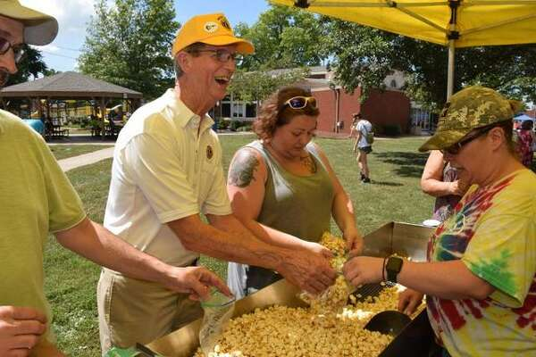 Wood River Lions Club members bag popcorn to be enjoyed by ice cream social visitors on Sunday.