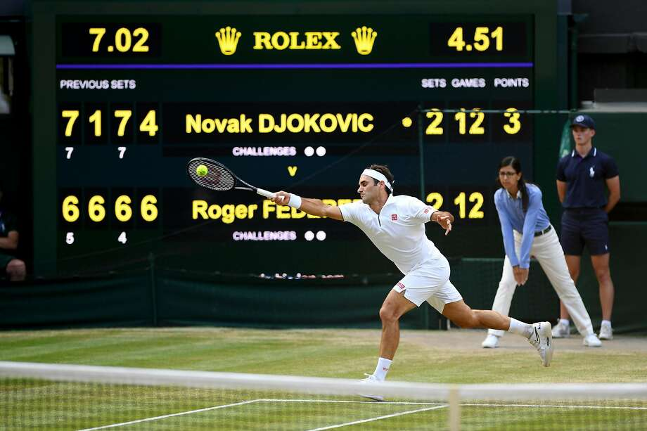 LONDON, ENGLAND - JULY 14: The scoreboard is seen as Roger Federer of Switzerland plays a forehand in the final set in the Men's Singles final between Novak Djokovic of Serbia and Roger Federer of Switzerland during Day thirteen of The Championships - Wimbledon 2019 at All England Lawn Tennis and Croquet Club on July 14, 2019 in London, England. (Photo by Matthias Hangst/Getty Images) Photo: Matthias Hangst / Getty Images