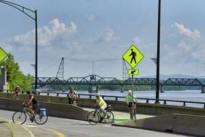 Bicyclists make their way along the bike trail on the final day of the 21st annual Cycle the Erie Canal tour on Sunday, July 14, 2019, in Albany, N.Y. More than 650 cyclists took part in the ride crossing New York State along the Erie Canalway Trail between Buffalo and Albany.  (Paul Buckowski/Times Union)