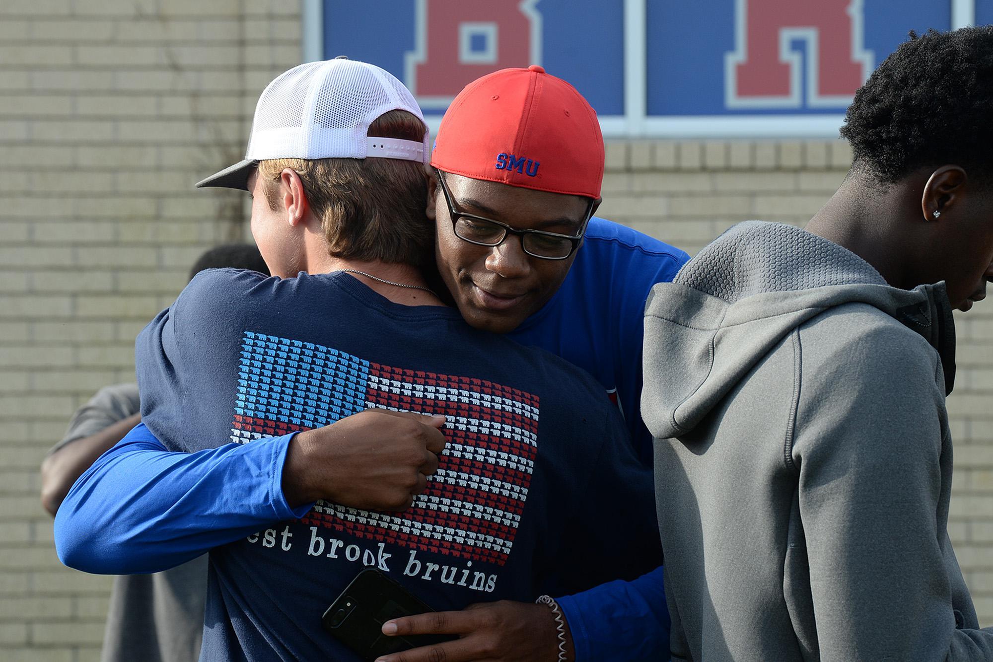 Community prays over injured West Brook players