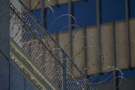 LOS ANGELES, CA - JULY 14: Razor wire is seen on the Metropolitan Detention Center prison as mass arrests by federal immigration authorities, as ordered by the Trump administration, were supposed to begin in major cities across the nation on July 14, 2019 in Los Angeles, California. The U.S. Immigration and Customs Enforcement was expected to be target hundreds of Angelenos for deportation, plus family members and others they encounter and suspect of being undocumented. The city of Los Angeles declared itself a sanctuary city to reflect its policy since the 1970s of not allowing police to help immigration officials because the city wants its immigrant populations to not be afraid to cooperate with police or call in crimes and emergencies. Elected officials and activists have continued to lash out against the raids. (Photo by David McNew/Getty Images)