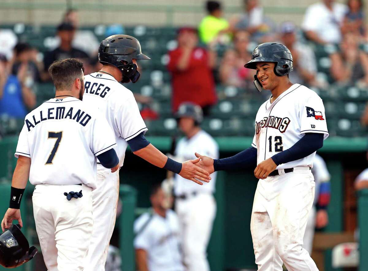 Missions Trent Grisham is congratulated by Lucas Erceg and Blake Allemand after his two run HR in the fourth inning. Omaha v Missions on Sunday, July 14,2019 at Wolff Stadium.