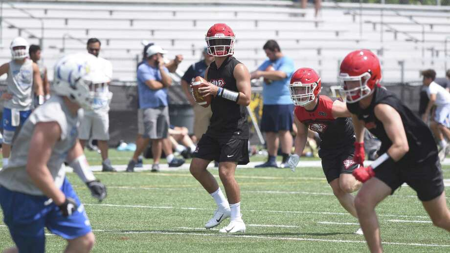 New Canaan quarterback Drew Pyne scans the field during the annual Grip It and Rip It football tournament at New Canaan High School on Friday, July 12, 2019. Photo: Dave Stewart / Hearst Connecticut Media / Hearst Connecticut Media
