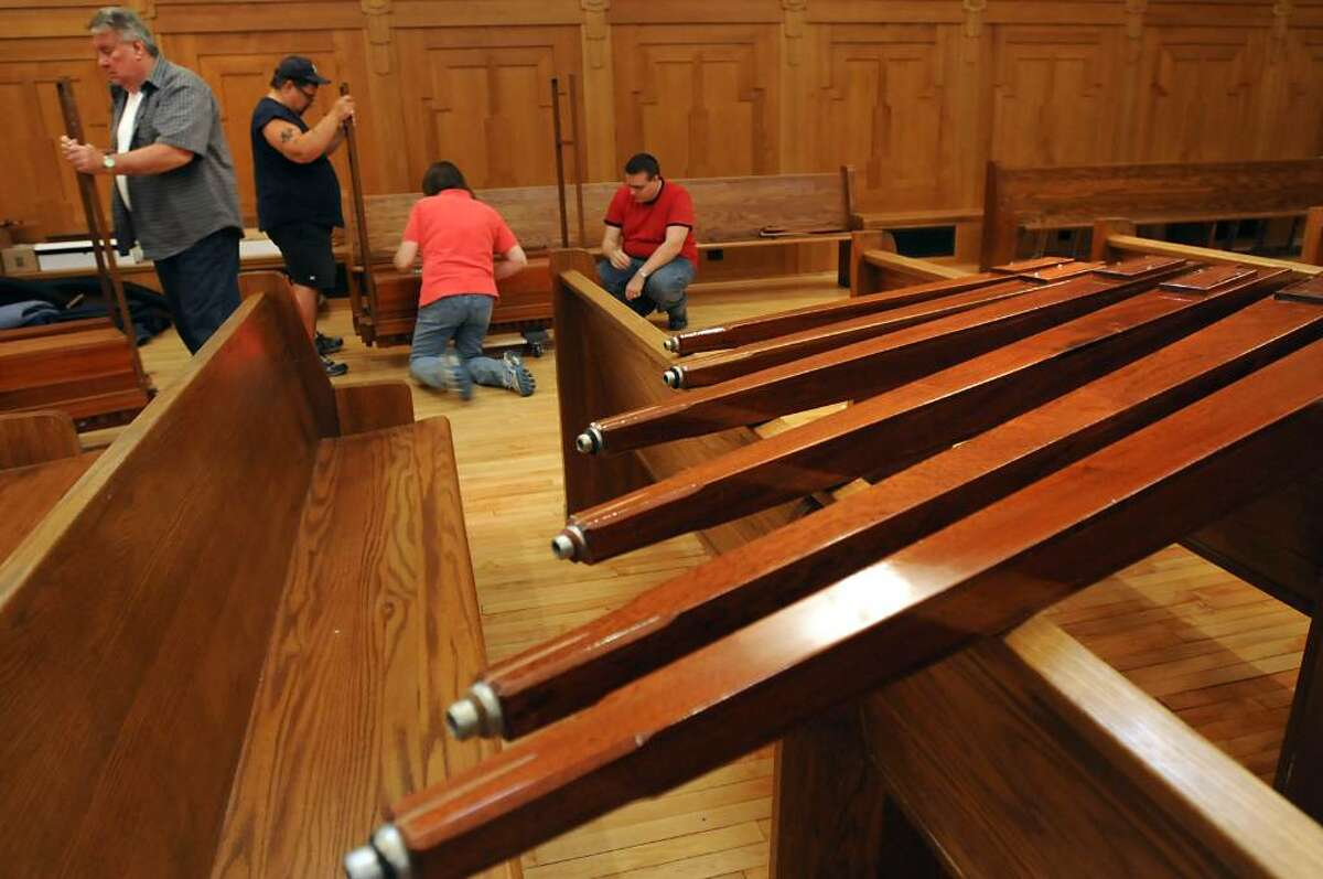 The Elsener Organ Work Inc. is assembling the organ. The workers from this company are, from left, Bill Stimpson, George Jugo, Jo Ellen Elsener, President, and Bill Sullivan. (Lori Van Buren / Times Union)