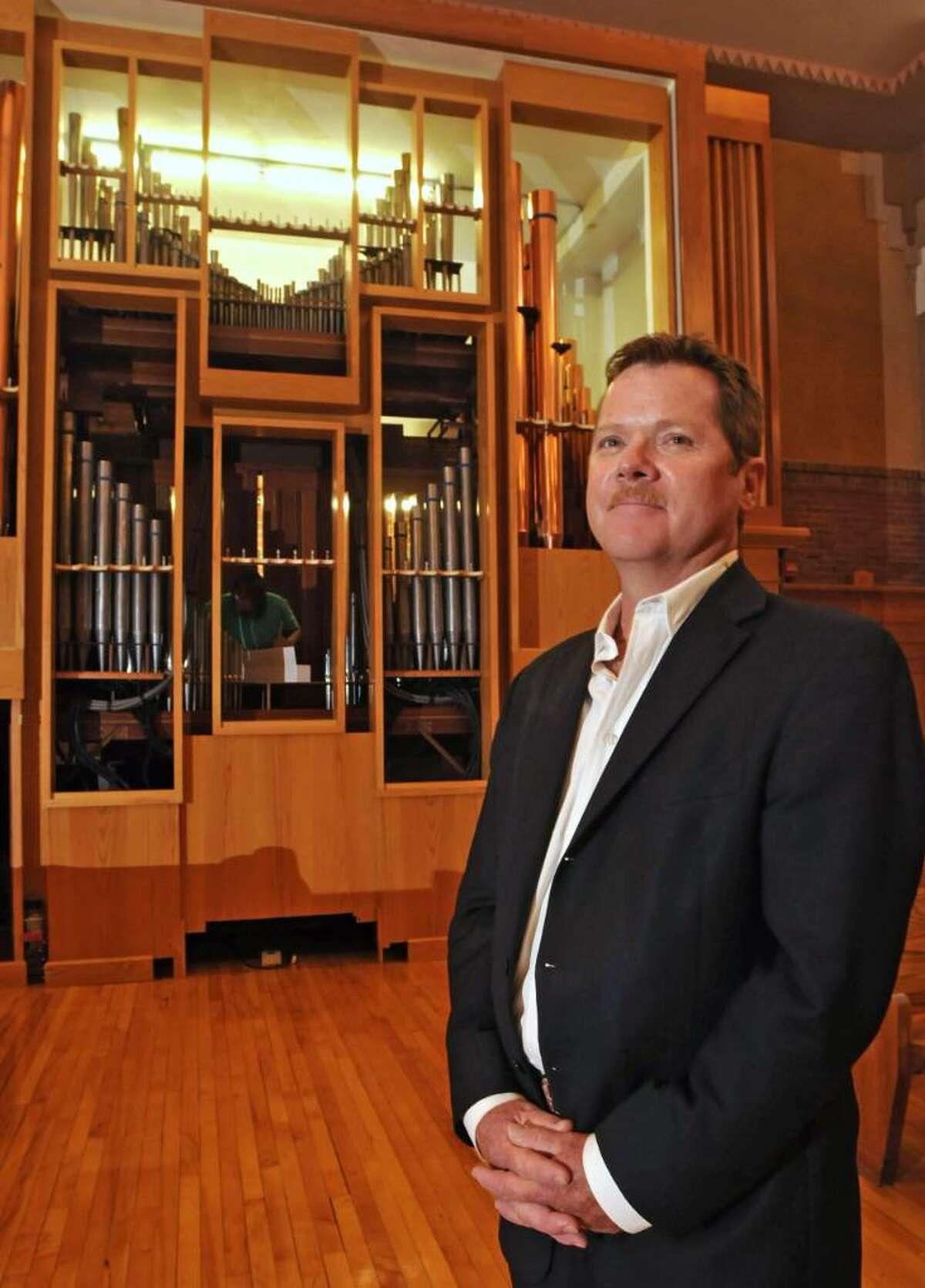 James Cole stands in front of the Ruffatti organ he donated to Doane Stuart School in Rensselaer. (Lori Van Buren / Times Union)