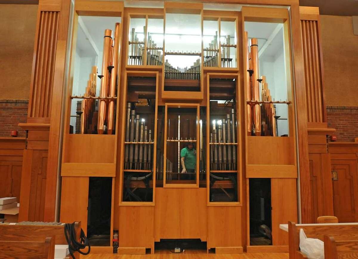 Workers are close to completing installation of the Ruffatti organ in Doane Stuart School. (Lori Van Buren / Times Union)