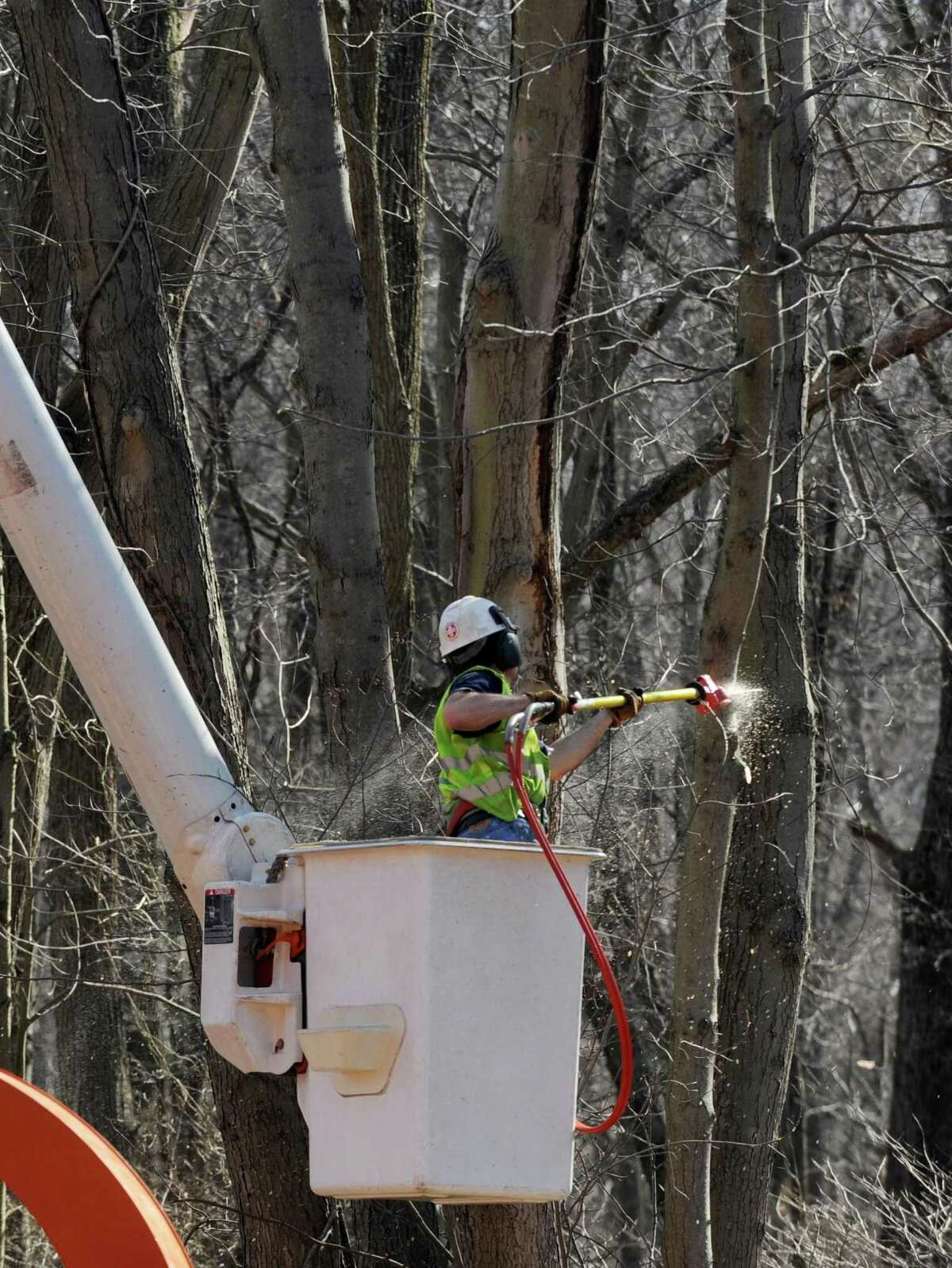 Conn. State Department of Transportation workers trim trees along the Merritt Parkway N just north of the Merwin's lane overpass in Fairfield, Conn. on Monday, march 12, 2012.