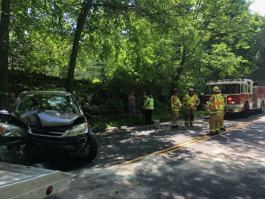 The Weston Fire Department and Weston Volunteer EMS responded to a single-car crash on Sunday, July 14, 2019 on Weston Road near Woodhill Road. The sole occupant was transported to the Norwalk Hospital with non-life threatening injuries. Photo: Weston Fire Department Photo
