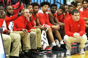 Alton coach Eric Smith (right) watches action from in front of the Redbirds bench during a game last season at Belleville East. Smith, after his final season with the Redbirds, is the 2018-19 Telegraph Large-Schools Boys Basketball Coach of the Year.