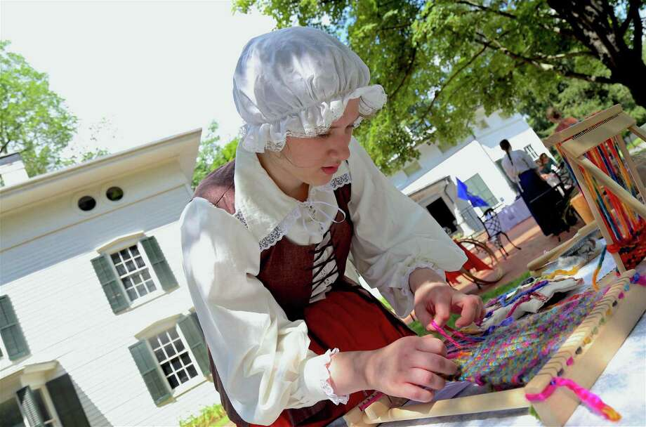 Volunteer Cassie Lang of Westport demonstrates some weaving at the Westport Historical Society's family day event commemorating the 1779 burning of Greens Farms, on Saturday, July 13, 2019, in Westport, Conn. Photo: Jarret Liotta / Jarret Liotta / ©Jarret Liotta