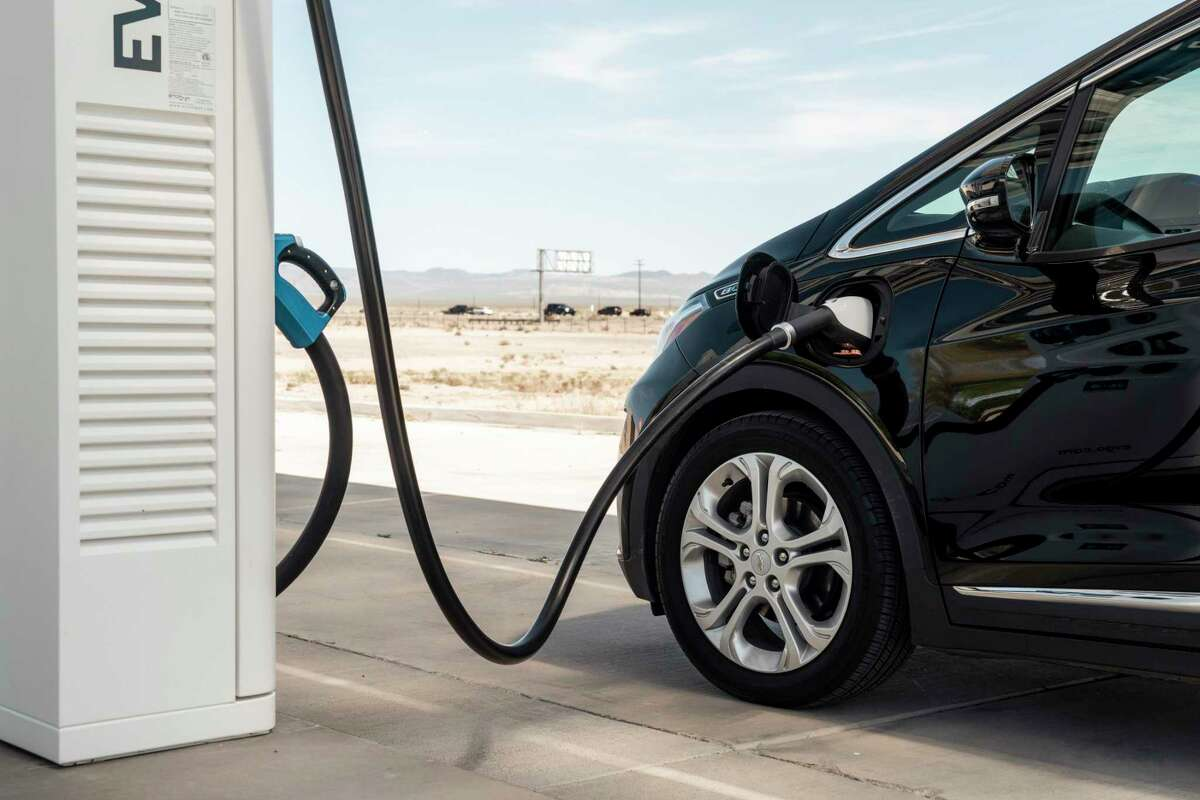 A Chevy Bolt charges at an EVgo charging station. More charging infrastructure is needed to make electric vehicle adoption more likely in cities such as Houston.