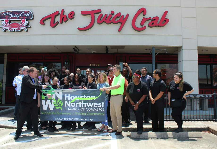 Todd Strickland, director of marketing and franchise sales for The Juicy Crab, cuts the ribbon on The Juicy Crab's first Texas location in Houston during a grand opening celebration on July 11. Photo: Melanie Feuk